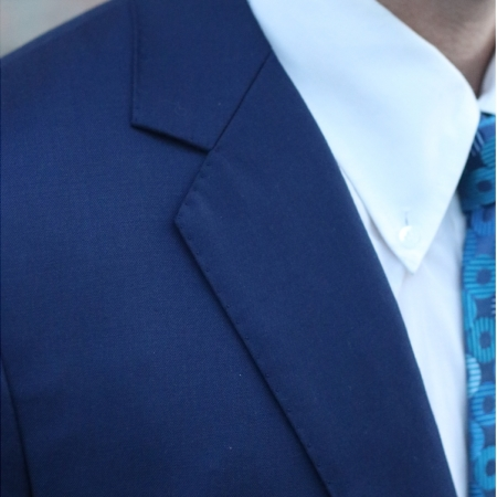 Wedding suit navy lapel pickstitch closeup
